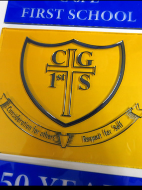 Stained glass school badge